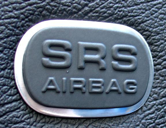 Air bag shields in the doors